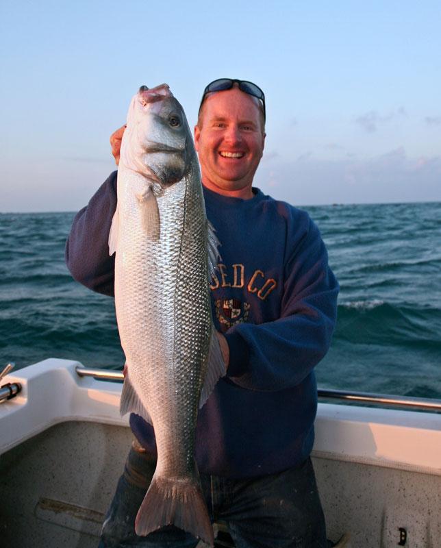 Mark Harding displays an Alderney bass