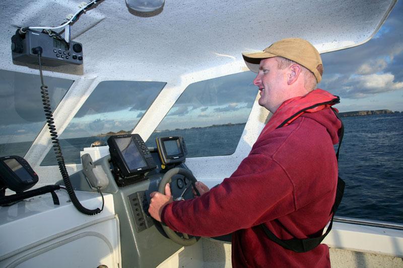 Mark Harding at the wheel at sea