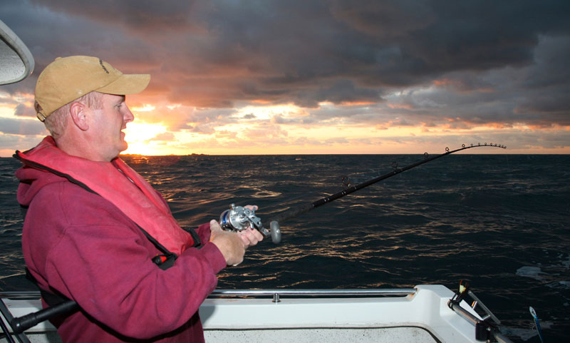 Mark Harding at sea off Alney as the sun sets