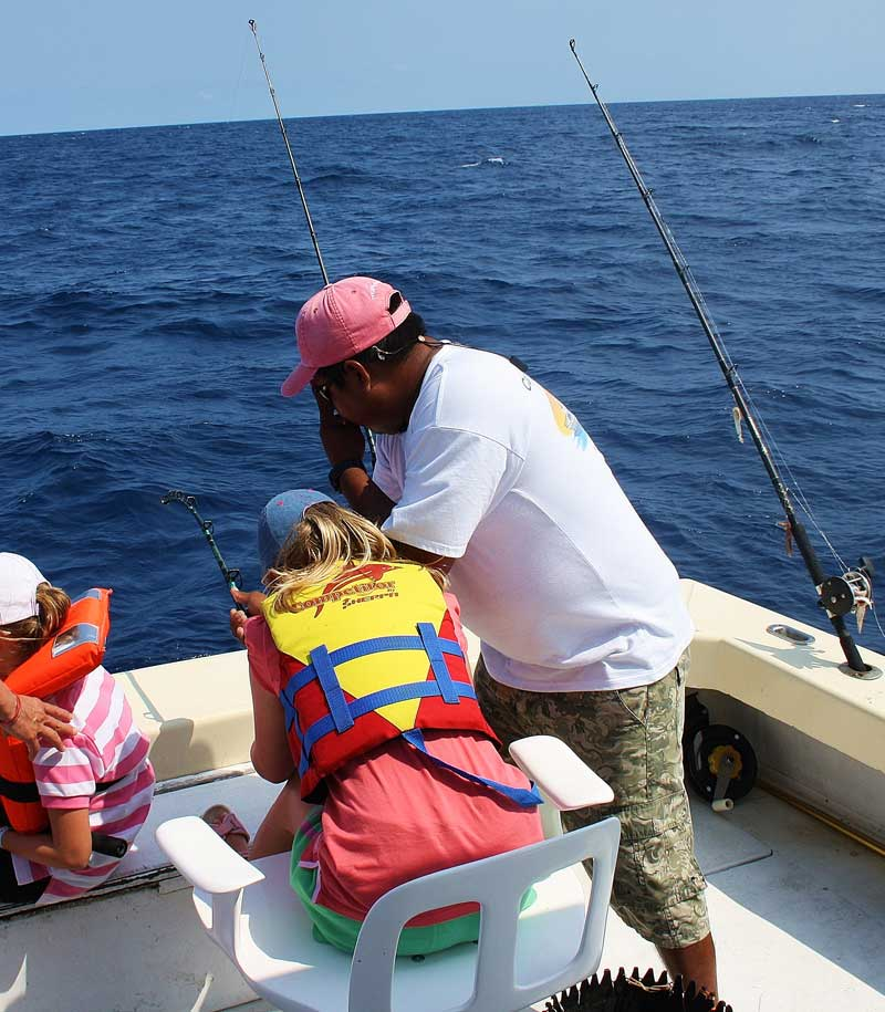 Puerto Aventuras fishing with Captain Rick Polly in the chair