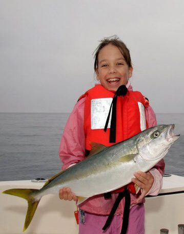 Bronwyn Westmore holds up a San Diego yellowtail