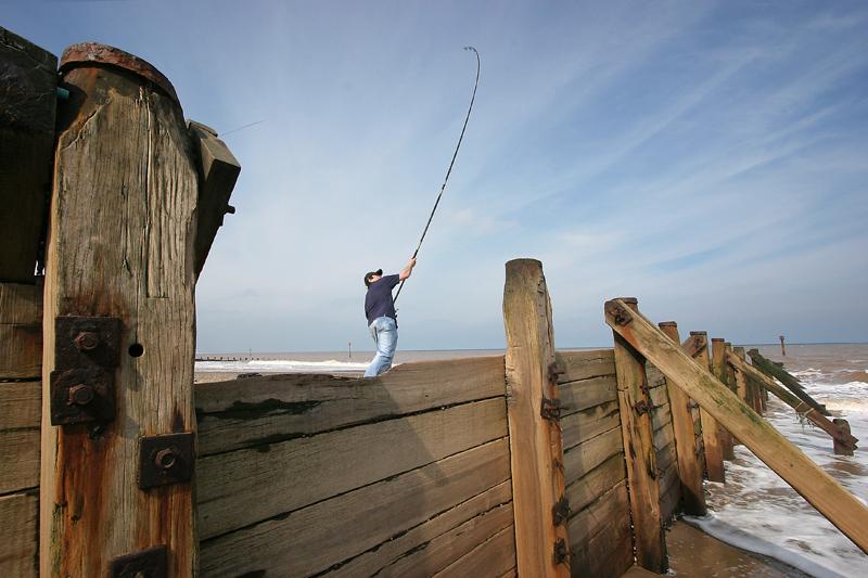 shore angler casting near a groybe