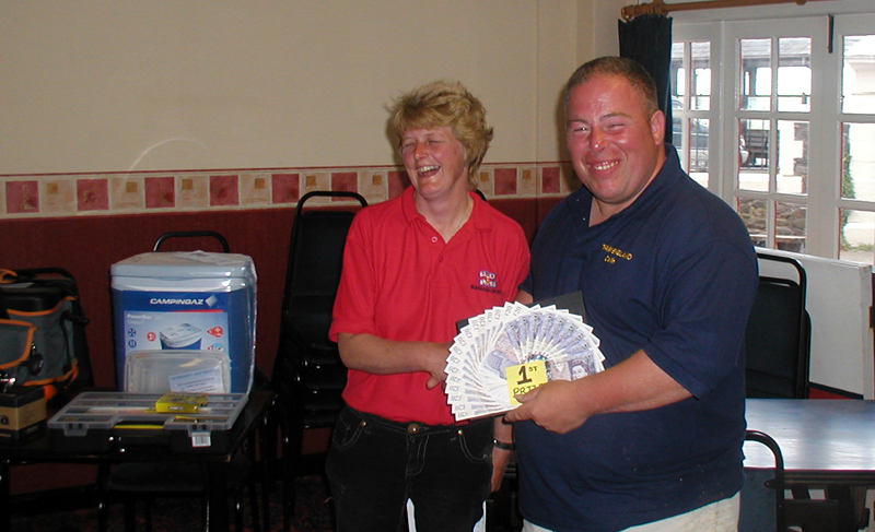 Colin Searles collects his winnings