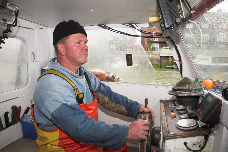 Lynander skipper Dickie Leggett at the wheel