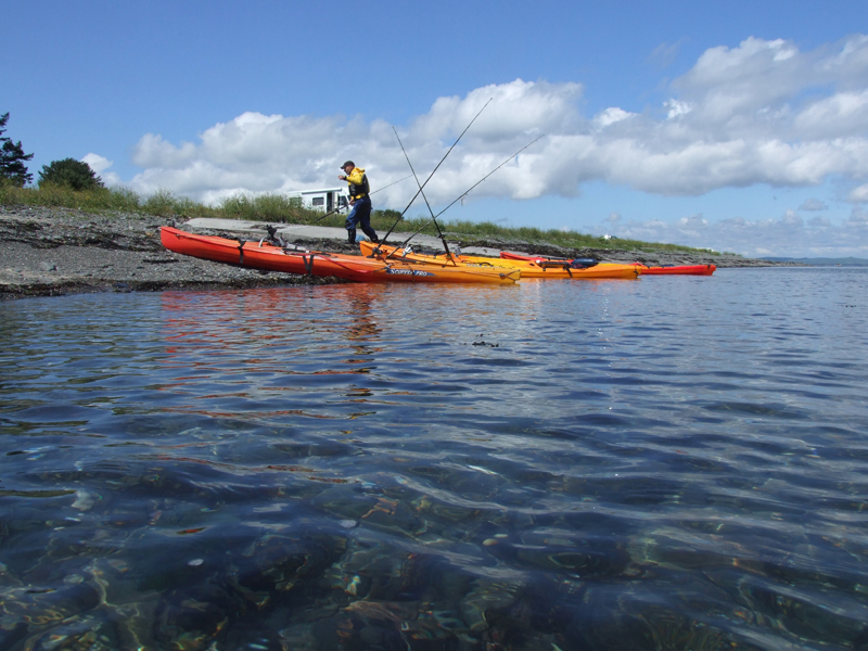 kayaks parked up on a shingle beach