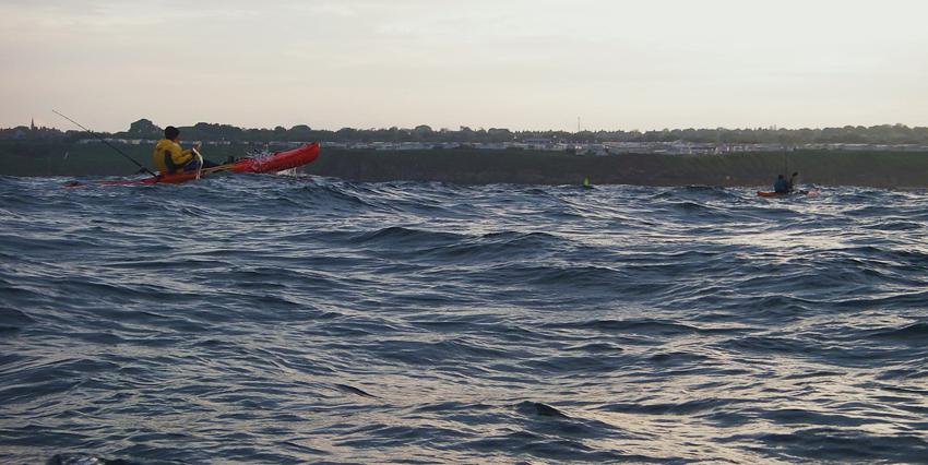 kayak anglers enjoying a bouncy day at sea