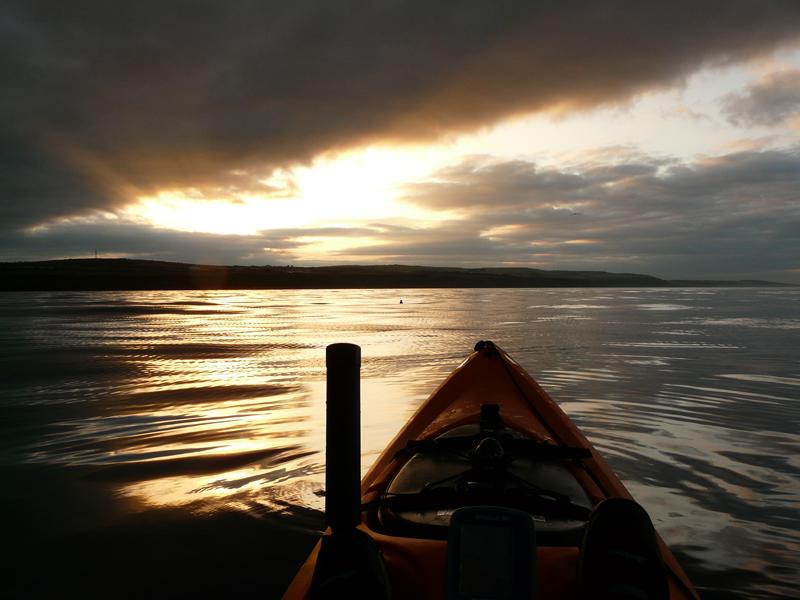 a kayak at sea under darkening skies