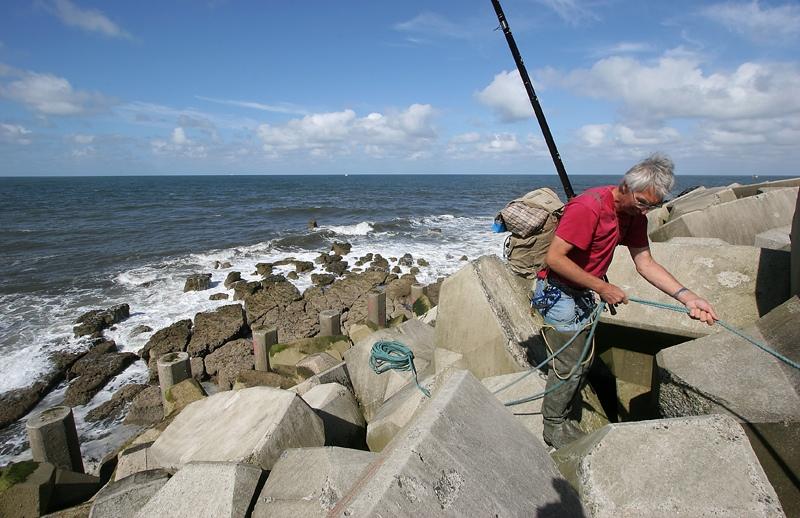 climbing the concrete coastal protection at Marine Drive