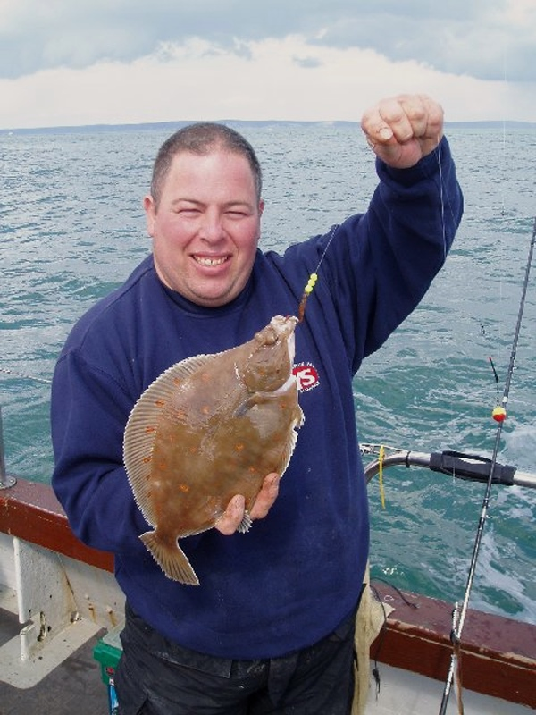 Colin Searles shows a red spotted plaice