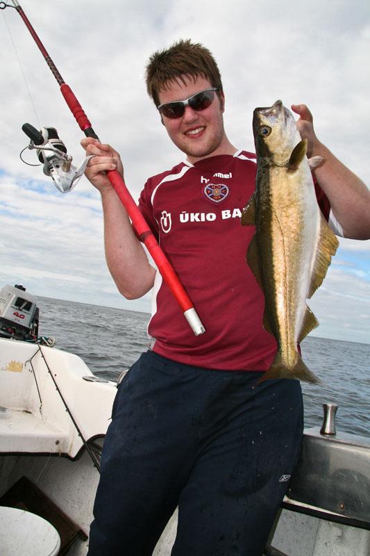 a pollack on the Grauvell Teklon 2400 boat rod
