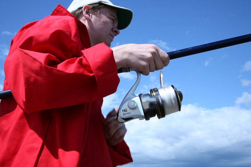 angler using Grauvell Zenith Z5000 fixed spool reel