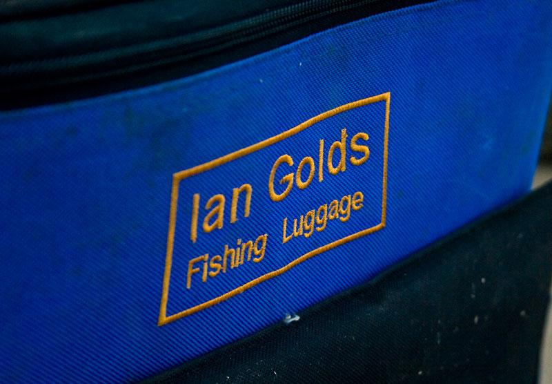 the Ian Golds Large Backpack logo
