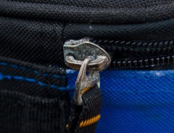 the Ian Golds Large Backpack zips