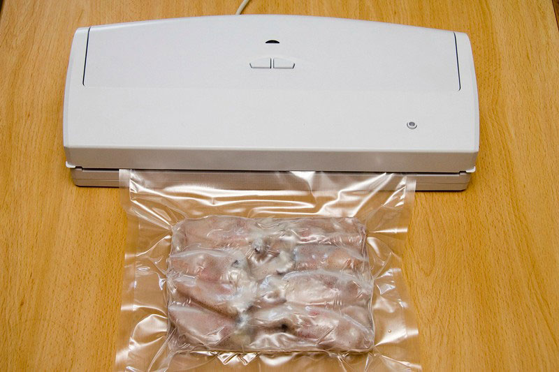vaccuum sealer in use