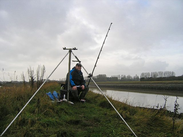 an angler watching his rod beside the Arun