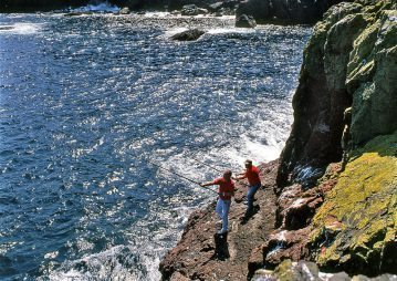 two anglers on the rocks at St Abbs Head
