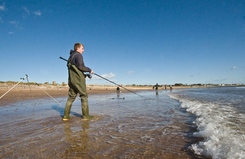 angler winds in on Elliot beach
