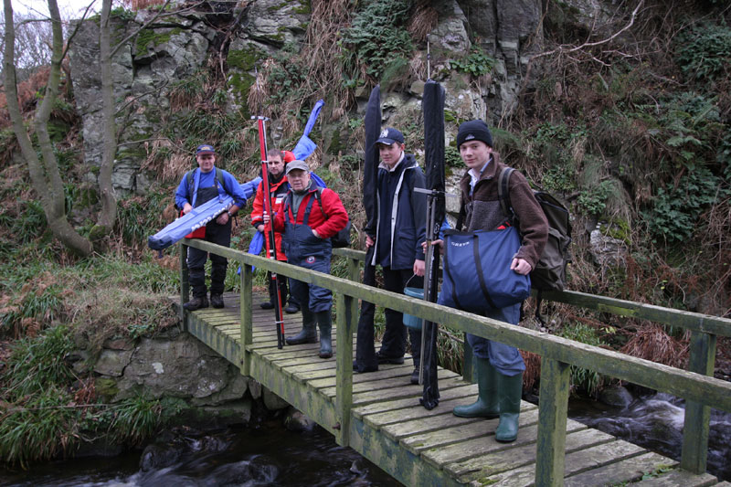 the group of anglers crossing a bridge on the way to Muchalls