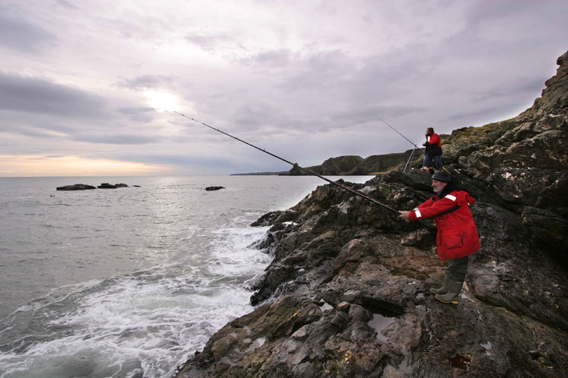 anglers on the rocks fishing for cod at Muchalls
