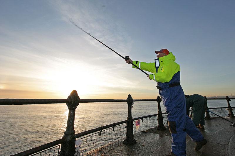 casting on Roker pier Sunderland at sunrise