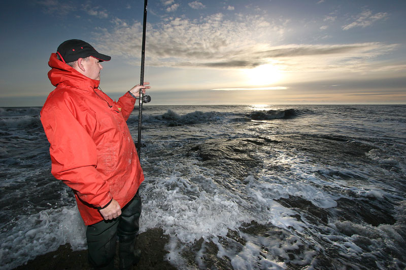 an angler surveys an powerful sea