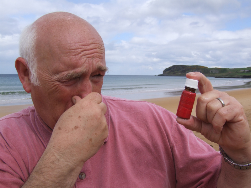 Norman Dunlop holds his nose at smell