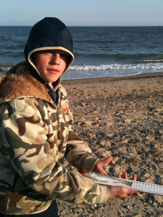measuring a fish on Kilgorman Beach