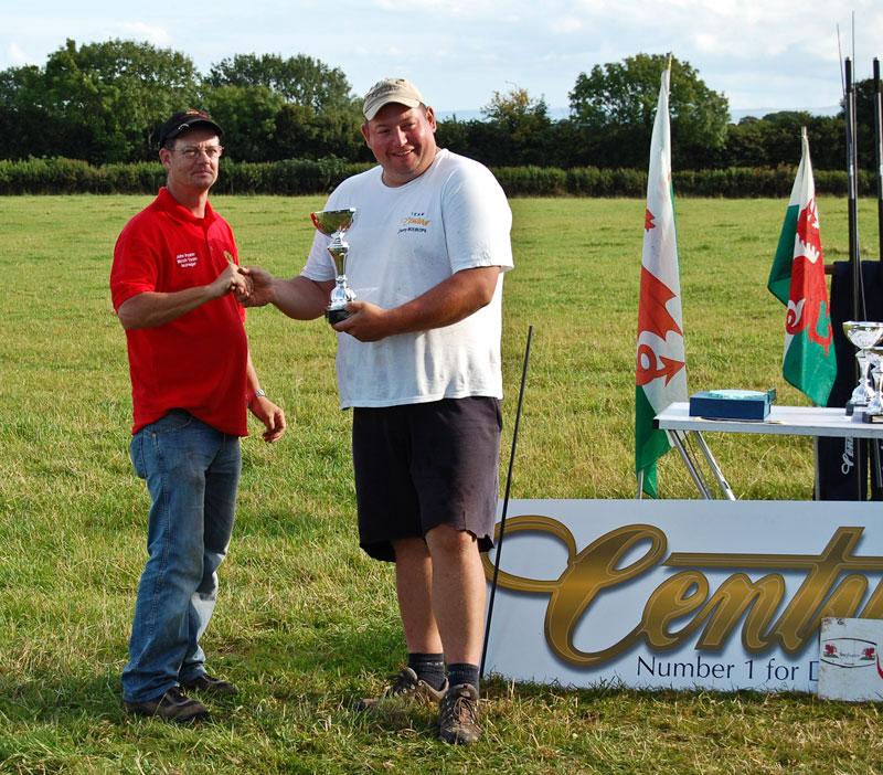 Danny Moeskops recieving his trophy at Surfcast Wales event