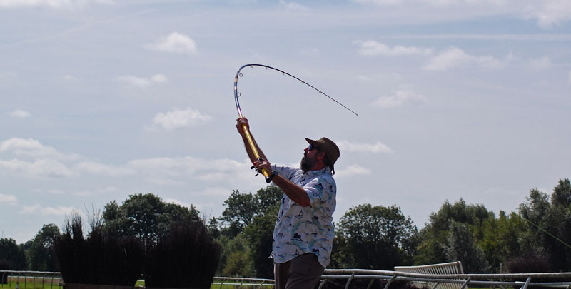 Neil Mackellow casting at at Surfcast Wales event