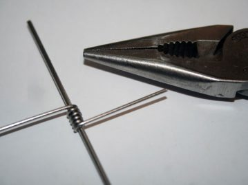 Making a spreader boom wire coil formed