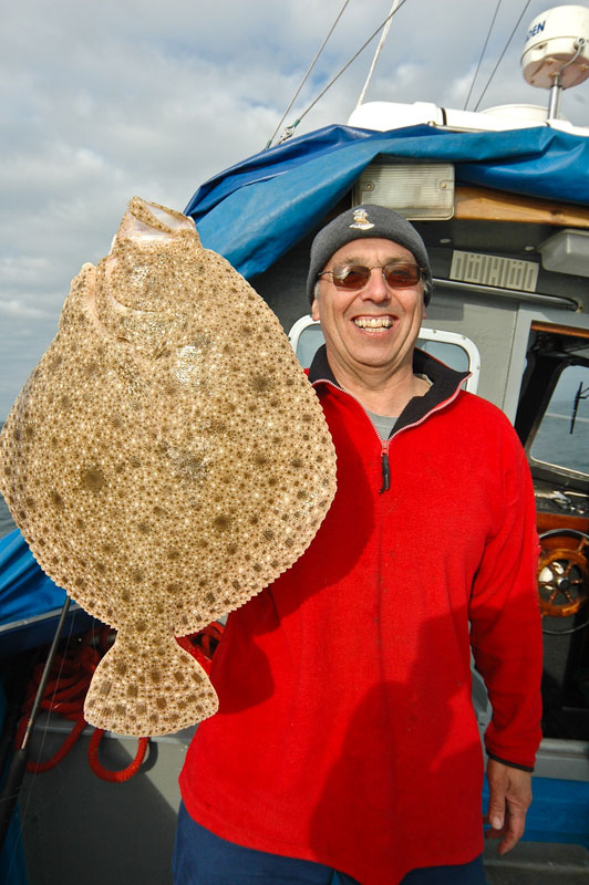 skipper Colin Dukes with an Alderney turbot