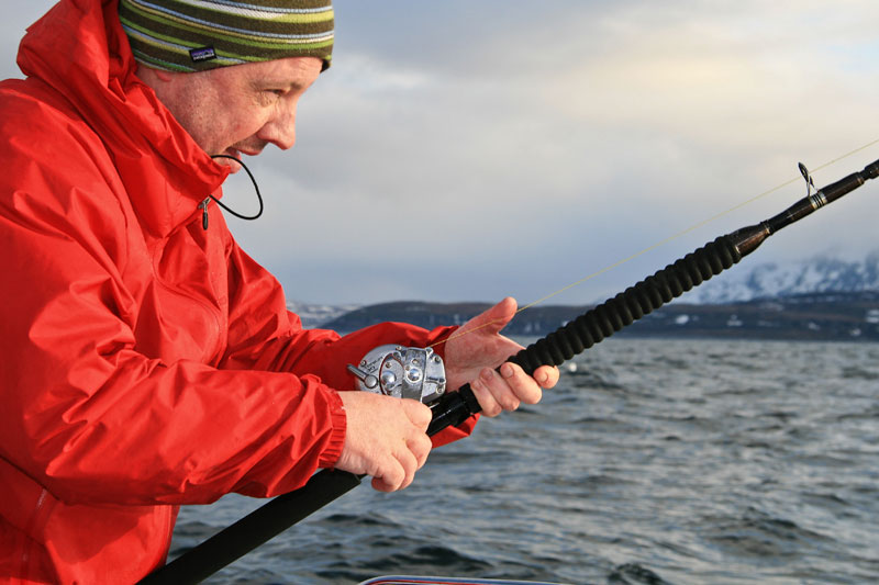 an agler concentrats on his rod