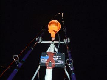 a lamp illuminates rods at night