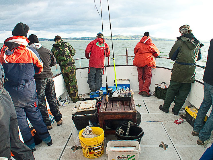 a goup of angler enjoying a properly booked charter boat trip