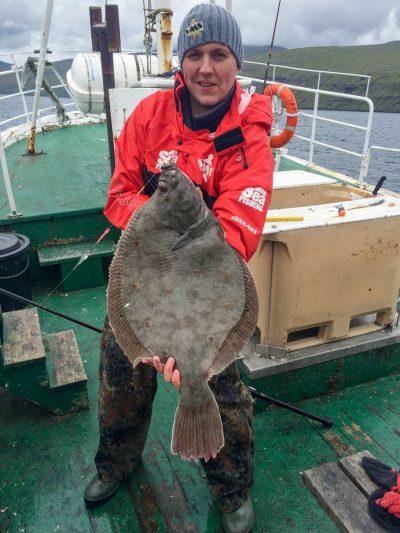 plaice fishing Faroe Islands Ally with a flattie
