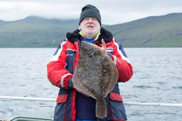 plaice fishing Faroe Islands author with a fish