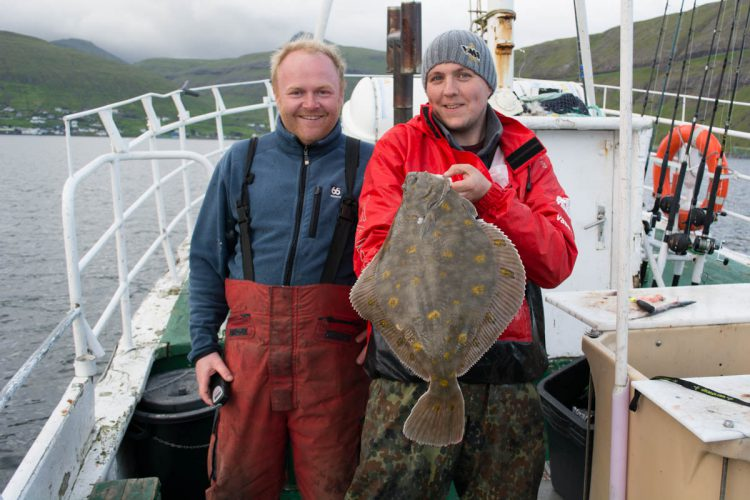 plaice fishing Faroe Islands Magni and Ally with a fish