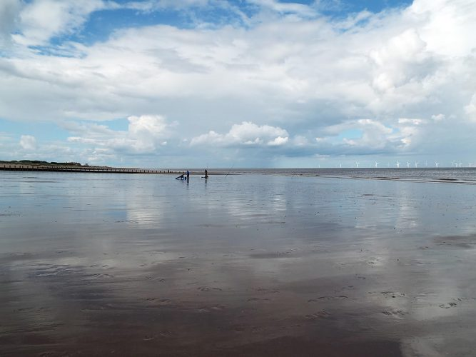 the flat expanse of a Lincolnshire beach