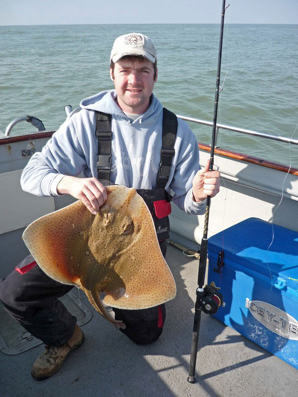 a blonde ray on a Fin Nor Offshore OFC16H Reel