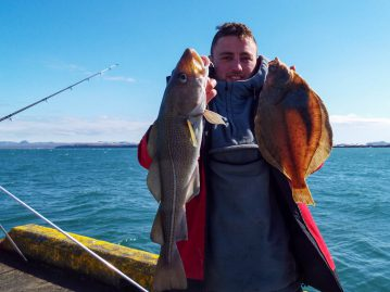 shore fishing Iceland Matt with a cod and dab