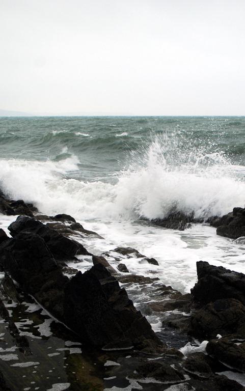 surf pounds the rocks at an Irish bass mark