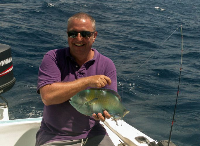 fihsing in Mexico parrot fish
