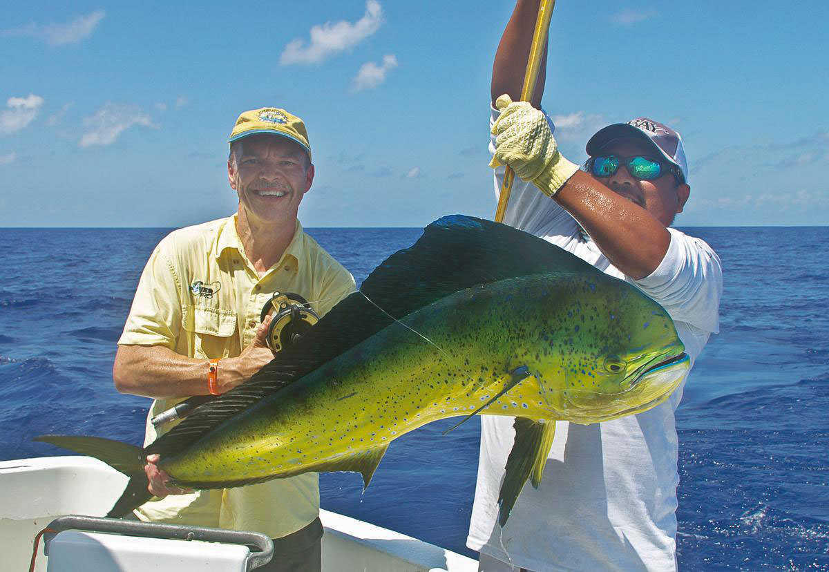 Des with Nestor and the female Dorado that took the 50lb outfit