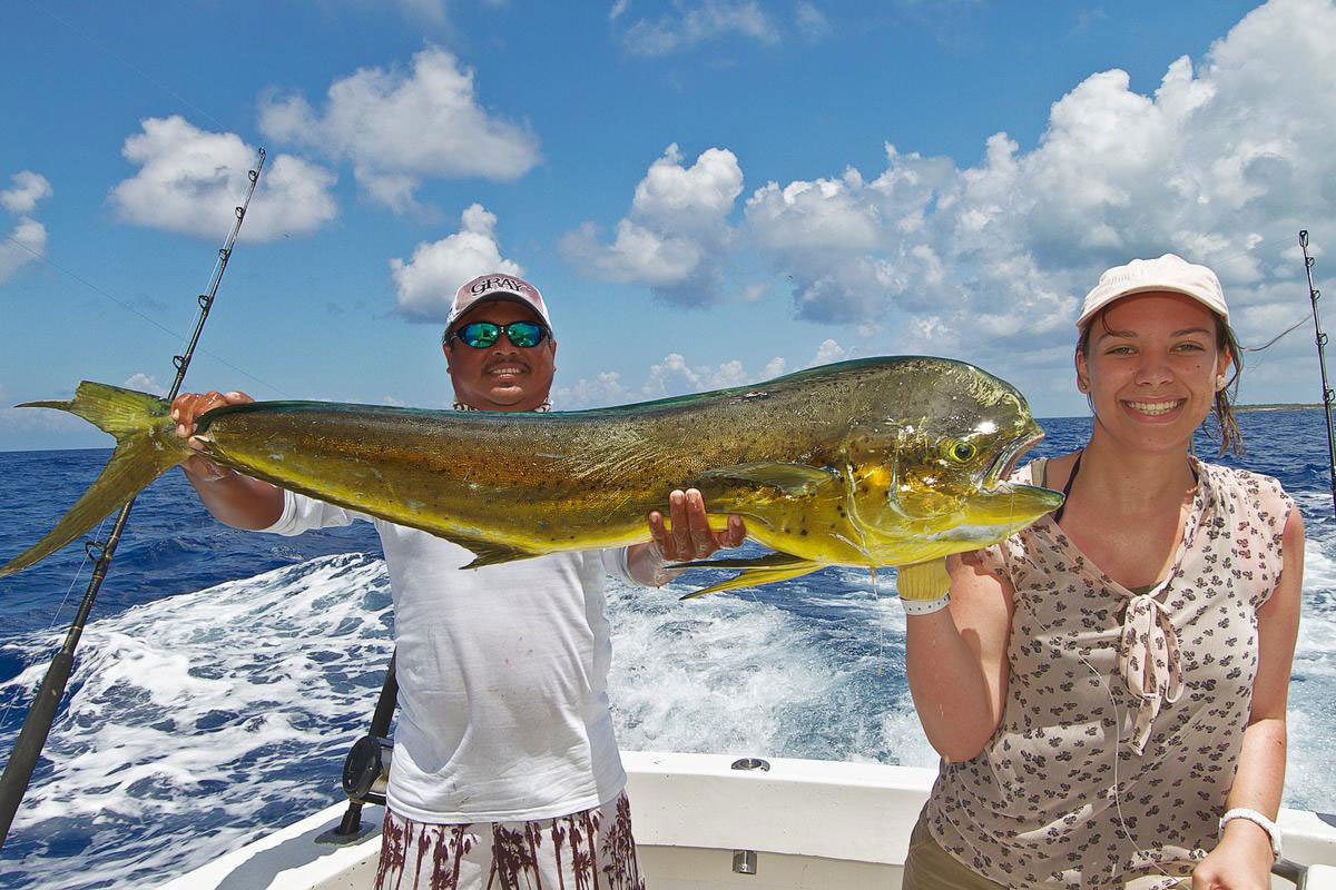 Bronwyn and Nestor pose with the first fish of the day