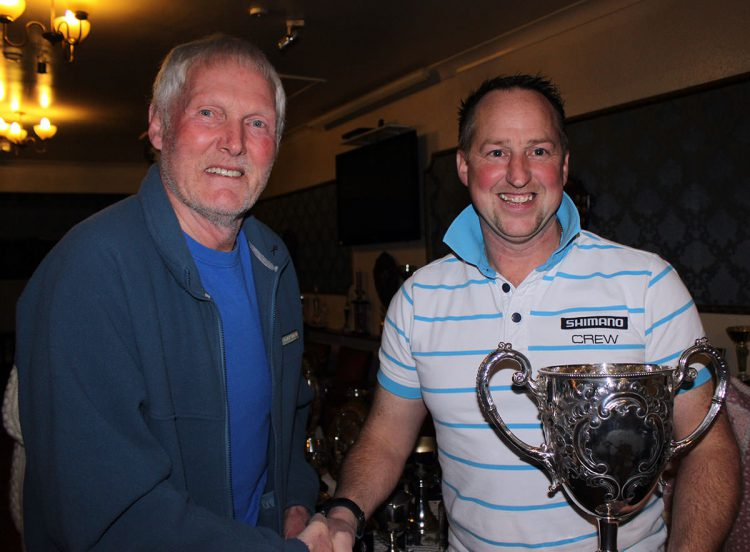 Adie Cooper (right) receiving one of his trophies from Alan Steadman