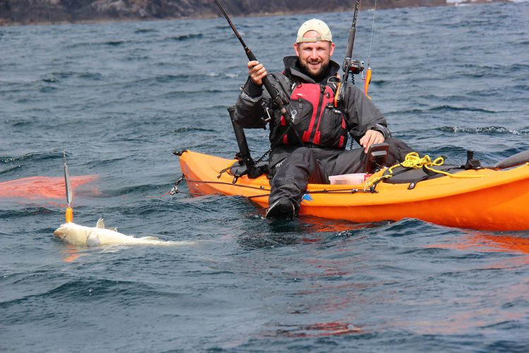 Adam Cain with a nice kayak cod