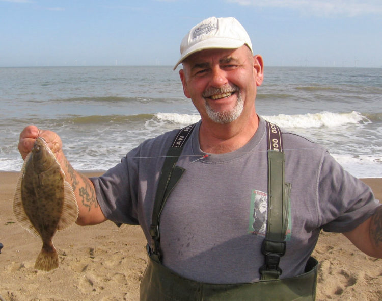 Third placed Simon Drayton posing nicely with one of his two flounders