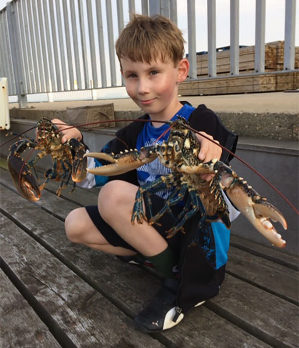 Young Nathaneil Williams landed these two fine lobsters