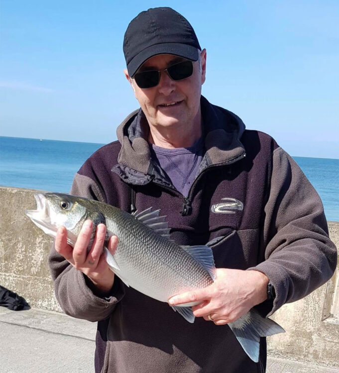 Clive Ward with a cracking bass caught on fresh worm