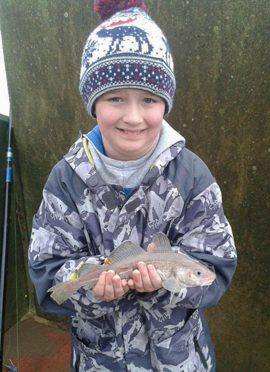Jayden Ferris, aged 9 with his first fish